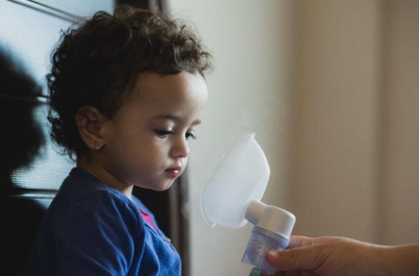 Asthma inhaler help child