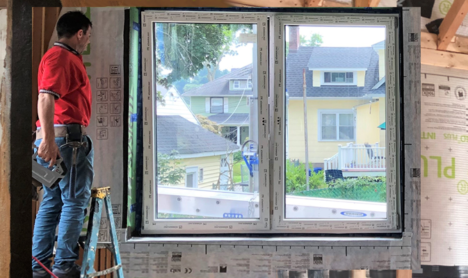 Energy Efficiency workers perform air-sealing and install windows, insulation